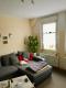 9,1% Rendite - Gut vermietete 2-Zimmer-Altbauwohnung in guter zentraler Lage - Wohnzi Couchecke